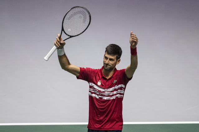 Serbia's Novak Djokovic celebrates his victory over France's Benoit Paire during their Davis Cup tennis match in Madrid, Spain, Thursday, Nov. 21, 2019. (AP Photo/Bernat Armangue)