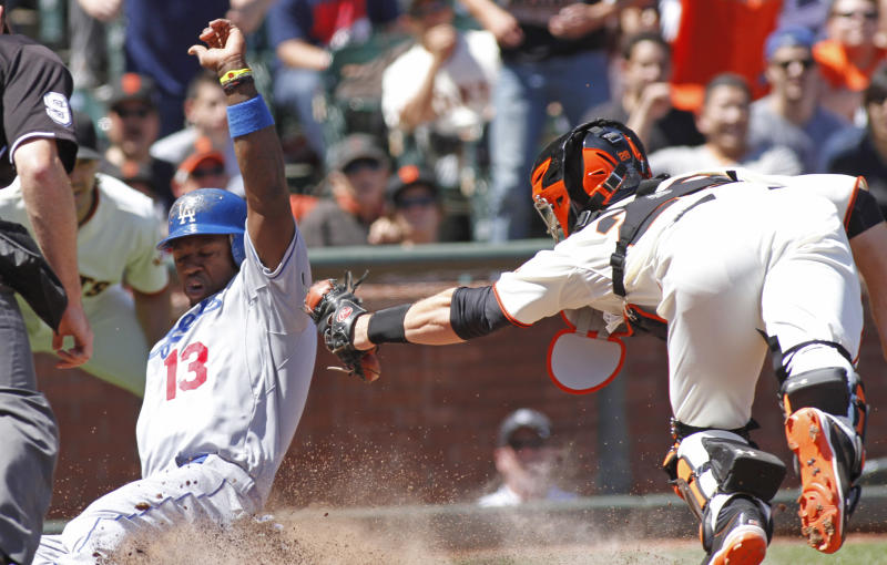 Los Angeles Dodgers' Hanley Ramirez (13) scores around an attempted tag by San Francisco Giants catcher Buster Posey during the sixth inning of a baseball game in San Francisco, Saturday, July 28, 2012. Ramirez scored  on a double hit by Jerry Hairston Jr. (AP Photo/George Nikitin)