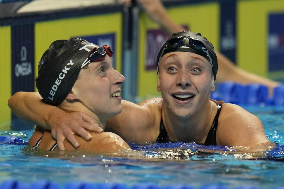 Katie Ledecky hugs Paige Madden, right, after winning the Women's 400 Freestyle during wave 2 of the U.S. Olympic Swim Trials on Monday, June 14, 2021, in Omaha, Neb. (AP Photo/Jeff Roberson)