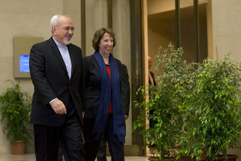 EU High Representative for Foreign Affairs Catherine Ashton, right, and Iranian Foreign Minister Mohammad Javad Zarif, arrive for a photo opportunity prior to the start of three days of closed-door nuclear talks in Geneva, Switzerland, Wednesday, Nov. 20, 2013. (AP Photo/Keystone,Salvatore Di Nolfi)