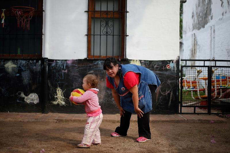 Noelia Garella, a kindergarten teacher born with Down Syndrome, is full of self-belief, despite being turned away from a nursery as a child (AFP Photo/Diego Lima)