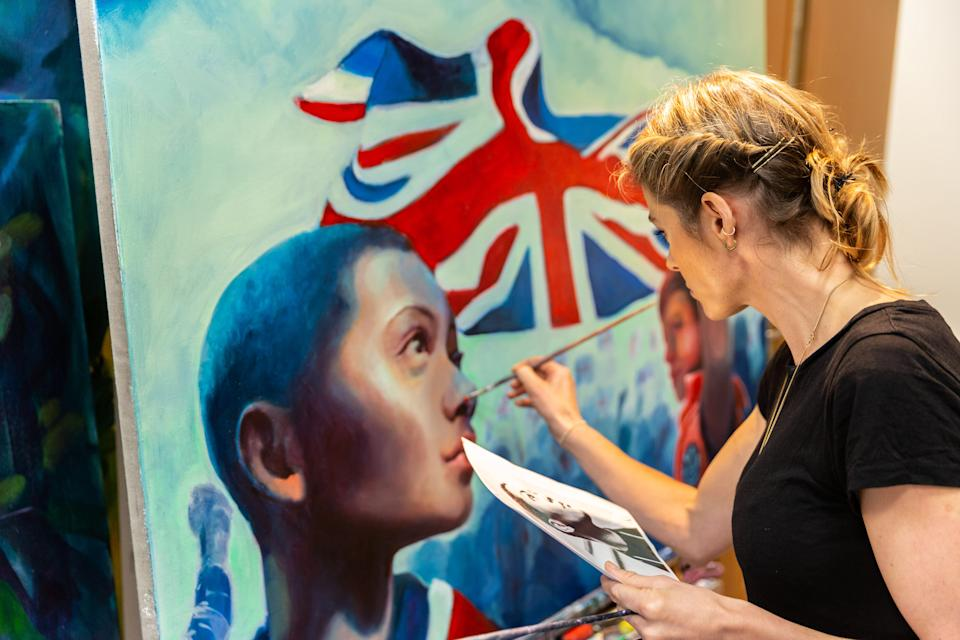 Triathlete turned full-time artist Vanessa Raw was commissioned by Purplebricks to produce a painting for the Home Support campaign - presented to Goodfellow in a special surprise