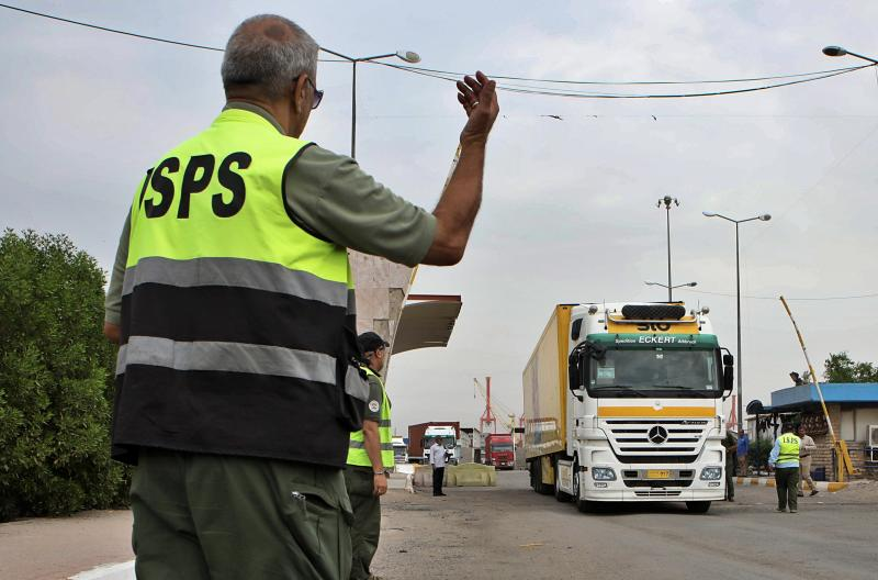 Trucks leave the port of Umm Qasr after being opened by security forces, Iraq, Thursday, Nov. 7, 2019. Iraqi officials say work has resumed in one of the country's largest ports after it was closed for days by Anti-government protesters. (AP Photo/Nabil al-Jourani)