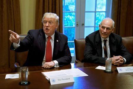 U.S. President Donald Trump gestures next to White House Chief of Staff John Kelly during a briefing with senior military leaders at the White House in Washington, DC, U.S., October 5, 2017. REUTERS/Yuri Gripas/Files