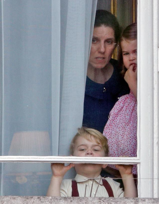 Prince George, Princess Charlotte and Maria Teresa Borrallo peer out of a window at Buckingham Palace during Trooping the Colour 2017