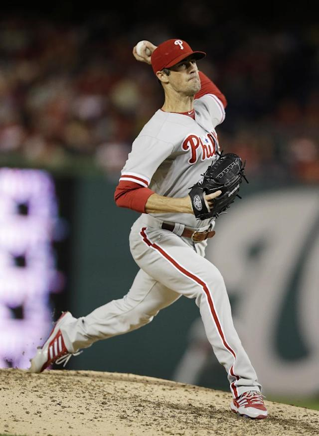 Philadelphia Phillies' Cole Hamels delivers a pitch against the Washington Nationals, during the fifth inning of a baseball game at Nationals Park, Saturday, Sept. 14, 2013, in Washington. (AP Photo/Pablo Martinez Monsivais)