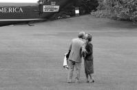 FILE - In this May 10, 1979 file photo, President Jimmy Carter pauses to kiss first lady Rosalynn Carter as he boards a helicopter in Washington, for the trip from the White House to Camp David, Maryland. Sign at upper left is on the tail of the helicopter. Jimmy Carter and his wife Rosalynn celebrate their 75th anniversary this week on Thursday, July 7, 2021. (AP Photo/Barry Thumma, File)