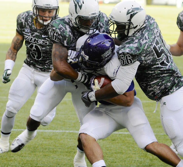 Weber State's Bo Bolen (8) is tackled by Portland State's David Edgerson (3), Aaron Sibley (36), Jeremy Boone (56) and Jaycob Shoemaker (6) during the first half of an NCAA college football game in Portland, Ore., Saturday Nov 2, 2013. (AP Photo/Greg Wahl-Stephens)
