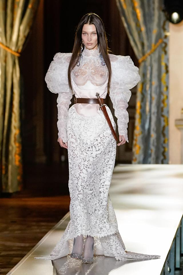 Bella Hadid took to the catwalk in a sheer wedding dress. Photo: Getty Images
