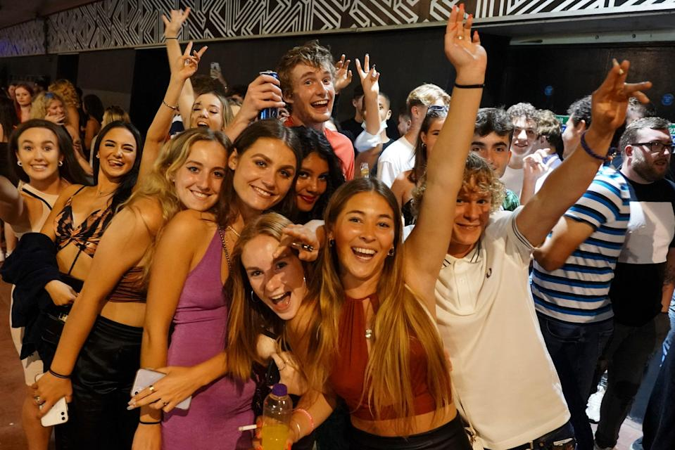 Let's get this party started: crowds outside a nightclub ahead of the midnight reopening   (Getty Images)