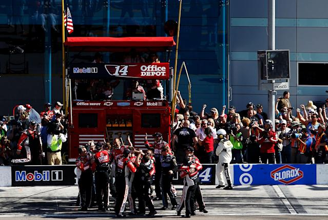 LAS VEGAS, NV - MARCH 11: The crew of Tony Stewart, driver of the #14 Mobil 1/Office Depot Chevrolet, celebrates after Stewart won the NASCAR Sprint Cup Series Kobalt Tools 400 at Las Vegas Motor Speedway on March 11, 2012 in Las Vegas, Nevada. (Photo by Tom Pennington/Getty Images)