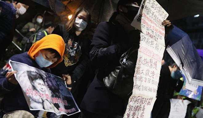 Protesters gather in Fo Tan, as a boy holds a picture with words condemning Carrie Lam. Photo: Felix Wong