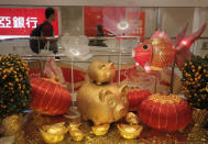 Chinese New Year decorations are displayed at an office building in Hong Kong, Thursday, Jan. 31, 2019. Chinese will celebrate the lunar new year on Feb. 5 this year which marks the Year of the Pig in the Chinese zodiac. (AP Photo/Vincent Yu)