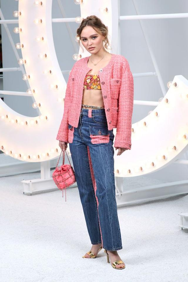 <p>Lily-Rose Depp dressed down her pink tweed jacket with jeans for the Paris Fashion Week show. </p>
