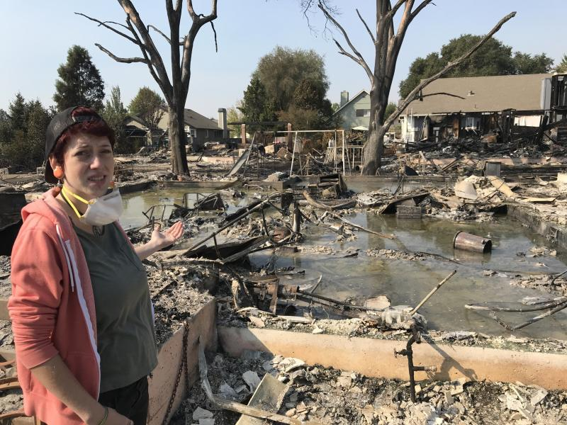 Kat Keller stands in front of what used to be her family's home. (Sarah Ruiz-Grossman/HuffPost)