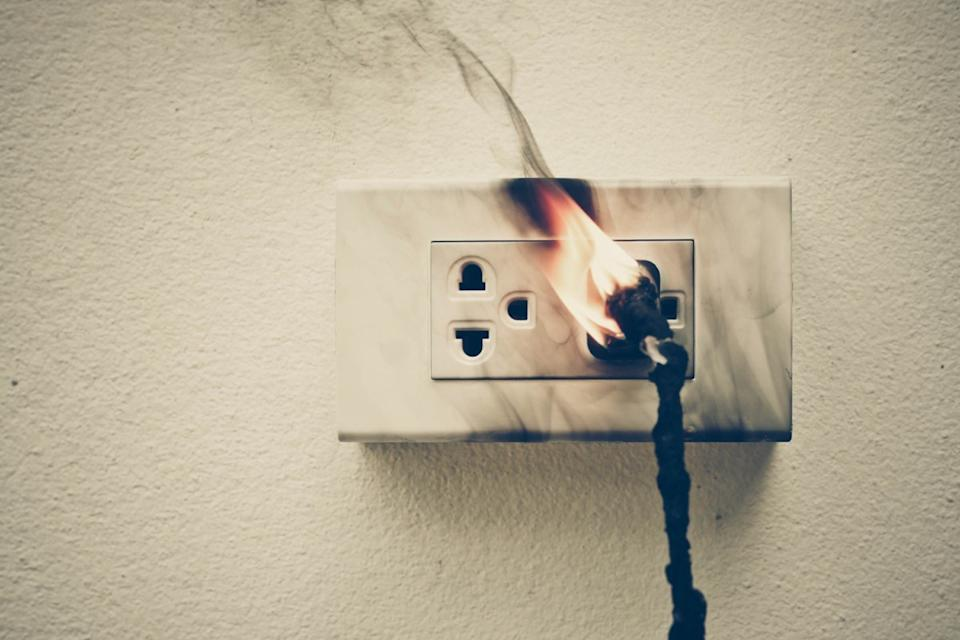 wall outlet on fire