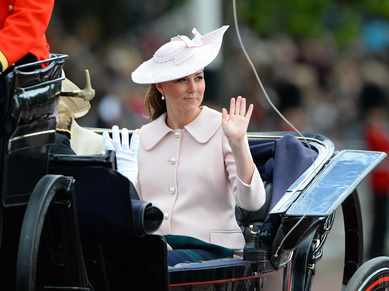 LONDON, ENGLAND - JUNE 15:  Catherine Duchess of Cambridge, travels by carriage along The Mall to the annual Trooping The Colour ceremony at Horse Guards Parade on June 15, 2013 in London, England.  (Photo by Julian Parker/UK Press via Getty Images)