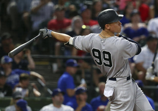 New York Yankees right fielder Aaron Judge (99) hits a solo home run against the Texas Rangersin the fifth inning of a baseball game Monday, May 21, 2018, in Arlington, Texas. (AP Photo/Richard W. Rodriguez)