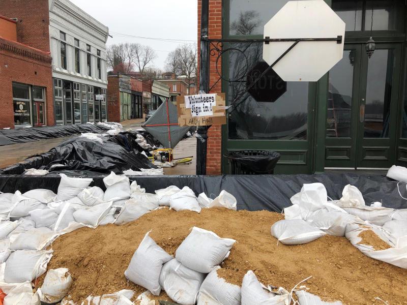 In this Friday, April 5, 2019, photo, streets are filled with sandbags and temporary levees in Clarksville, Mo. Clarksville is among a few small towns along America's rivers that can't afford flood protection. (AP Photo/Jim Salter)
