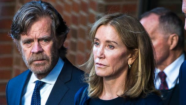 PHOTO: In this Sep. 13, 2019 file photo Felicity Huffman right, and her husband, William H. Macy, walk out of the John Joseph Moakley United States Courthouse in Boston. (Nic Antaya for The Boston Globe via Getty Images, FILE)