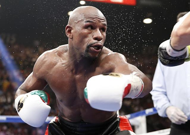 Floyd Mayweather Jr. is seen in his WBC-WBA welterweight title boxing fight against Marcos Maidana Saturday, May 3, 2014, in Las Vegas. (AP Photo/Eric Jamison)