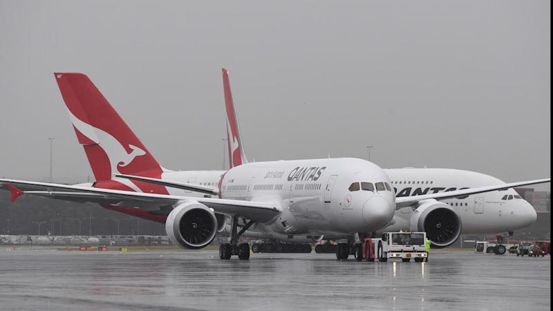 Qantas posts $607 million first-half profit