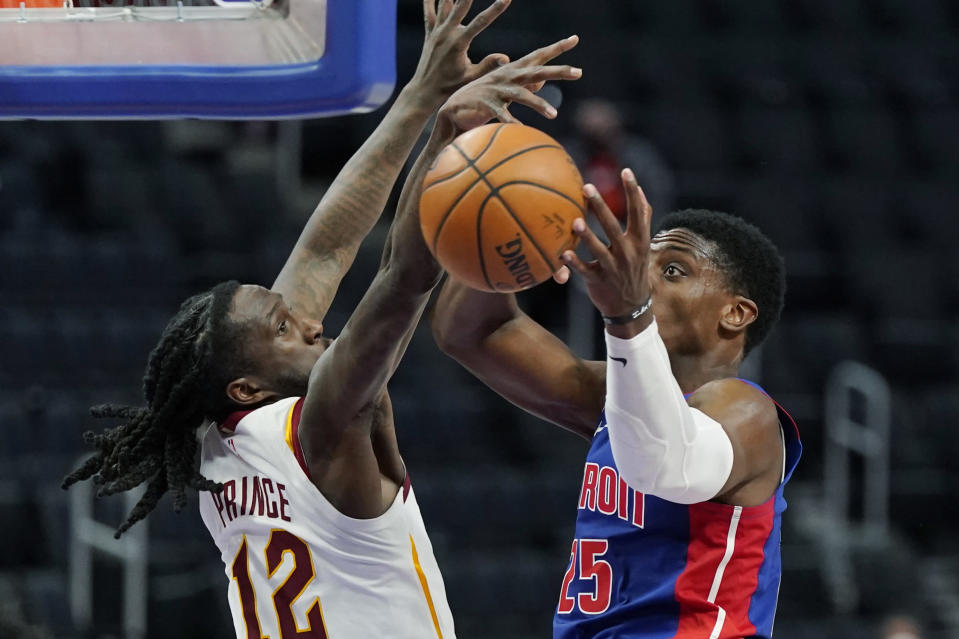 Cleveland Cavaliers forward Taurean Prince (12) knocks the ball away from Detroit Pistons forward Tyler Cook (25) during the second half of an NBA basketball game, Monday, April 19, 2021, in Detroit. (AP Photo/Carlos Osorio)