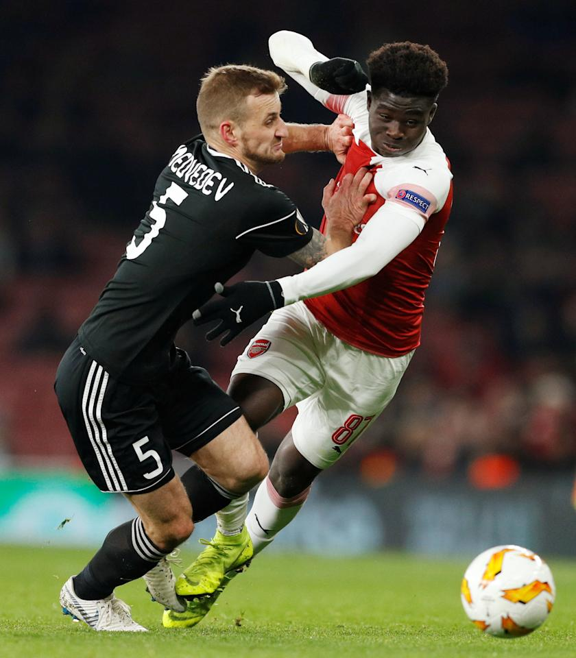Soccer Football - Europa League - Group Stage - Group E - Arsenal v Qarabag - Emirates Stadium, London, Britain - December 13, 2018  Arsenal's Bukayo Saka in action with Qarabag's Maksim Medvedev   Action Images via Reuters/John Sibley