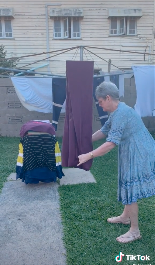 Folding a fitted sheet on a clothes line