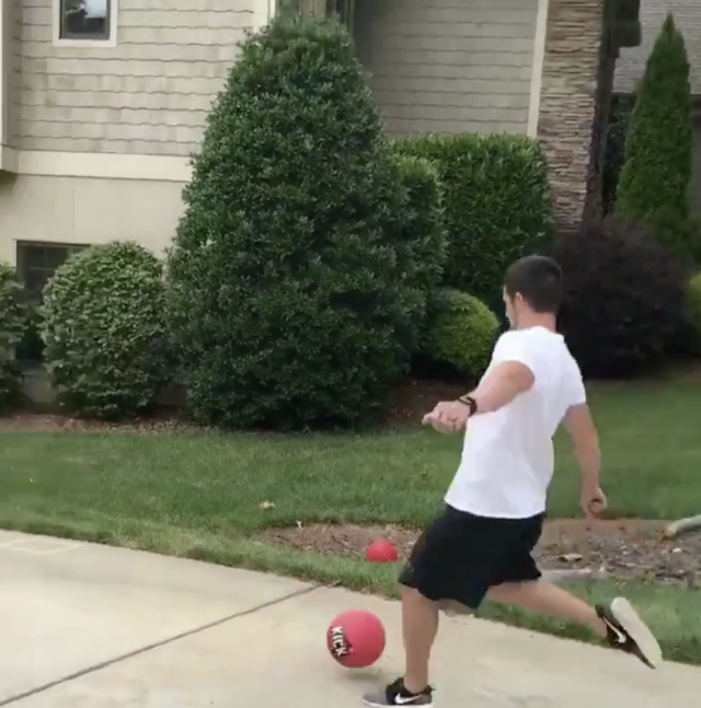 "Panthers kicker <a class=""link rapid-noclick-resp"" href=""/nfl/players/9526/"" data-ylk=""slk:Graham Gano"">Graham Gano</a> kicked a ball out well of his driveway and over the trees during a family game of kickball. (Twitter/Graham Gano)"