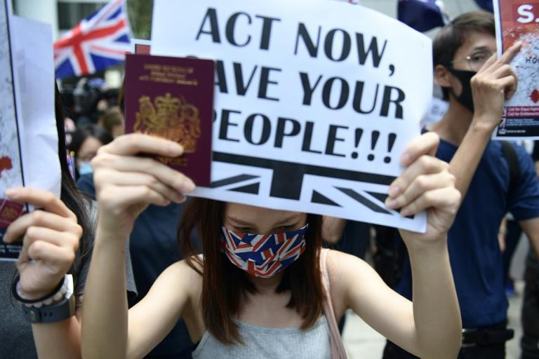 Protesters accused Britain of failing to hold Beijing to account over its treatment of Hong Kong (AFP Photo/Nicolas ASFOURI)