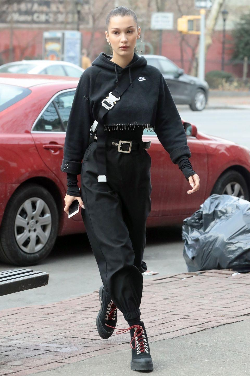 <p>In a cropped Nike sweater covered with a safety pin hem, black long sleeve shirt, high-waisted harem pants, and Off-White hiker boots while out in NYC.</p>