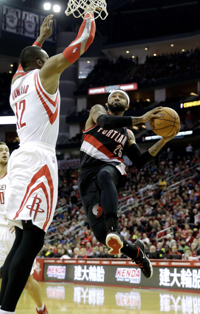 Portland Trail Blazers' Mo Williams (25) goes up to shoot as Houston Rockets' Dwight Howard (12) defends during the second quarter of an NBA basketball game on Sunday, March 9, 2014, in Houston. (AP Photo/David J. Phillip)