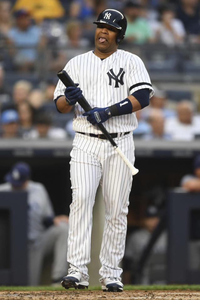 New York Yankees' Edwin Encarnacion reacts after striking out swinging during the second inning of a baseball game against the Tampa Bay Rays, Monday, June 17, 2019, in New York. (AP Photo/Sarah Stier)