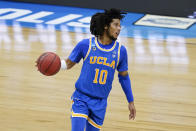 UCLA guard Tyger Campbell drives up court during the second half of an Elite 8 game against Michigan in the NCAA men's college basketball tournament at Lucas Oil Stadium, Tuesday, March 30, 2021, in Indianapolis. (AP Photo/Darron Cummings)