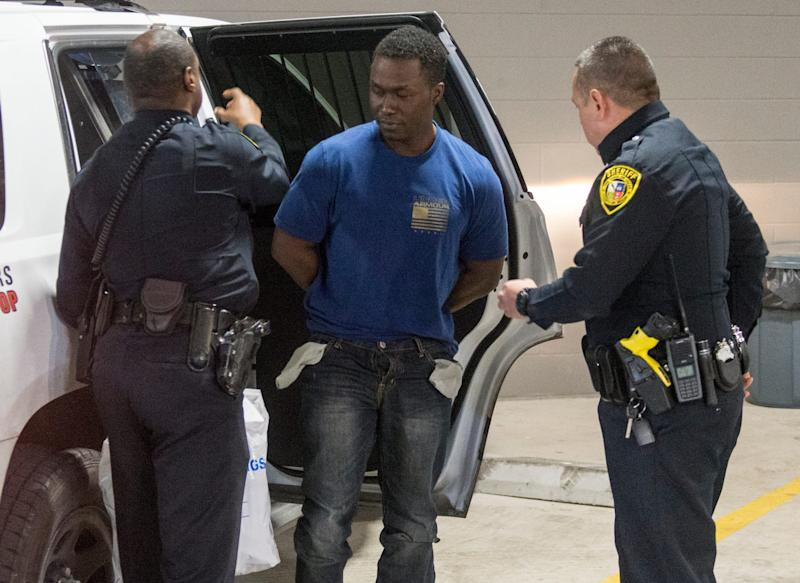 In this March 3, 2019, file photo, Air Force Maj. Andre McDonald, center, is escorted to the Bexar County Magistrate center in San Antonio.