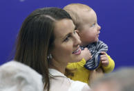 Minnesota Vikings new quarterback Kirk Cousins' wife Julie, holds their son Cooper, before Cousins was introduced during a news conference at the NFL football team's new headquarters Thursday, March 15, 2018, in Eagan, Minn. (AP Photo/Jim Mone)