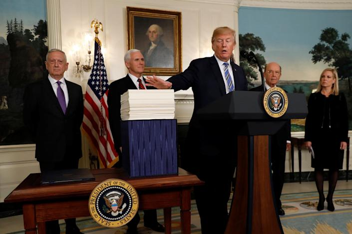 President Donald Trumptalks about Congress' $1.3 trillion spending bill during a signing ceremonyat the White Houseon Friday. (Photo: Kevin Lamarque / Reuters)