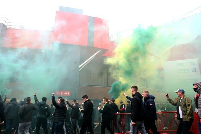 Fans make their way into the ground as they protest against the Glazer family on May 2