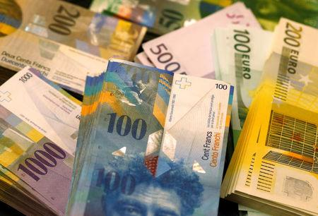 Euro banknotes of several values lie on a table in a Swiss bank in Bern