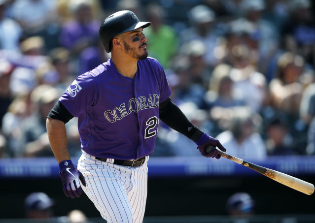 The Rockies' Nolan Arenado follows the flight of his sacrifice fly to drive in a run against Padres starting pitcher Joey Lucchesi on Aug. 23, 2018, in Denver. (AP Photo/David Zalubowski)