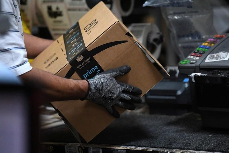 FILE PHOTO: Worker assembles a box for delivery at the Amazon fulfilment center in Baltimore