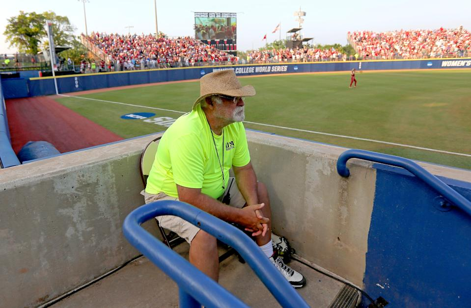 Usher Ed Koch watches during the second game of the Women's College World Series championship series between the University of Oklahoma Sooners (OU) and Florida State University at the USA Softball Hall of Fame Stadium in Oklahoma City, Wednesday, June 9, 2021.
