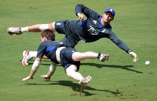 England's Jos Buttler (top) and Eoin Morgan dive to catch the ball during an ICC Twenty20 Cricket World Cup practice session at the Pallekele International Cricket Stadium in Pallekele, on September 26. The World Twenty20 shifts to a higher gear on Thursday when the hot favourites begin an intriguing race for the semi-finals in the Super Eights round