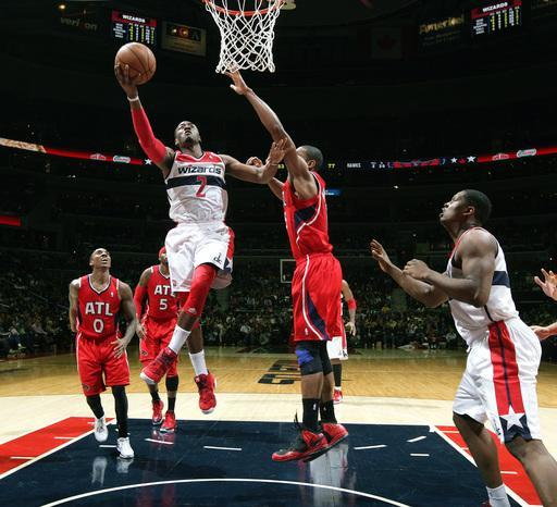 WASHINGTON, DC - JANUARY 12: John Wall #2 of the Washington Wizards shoots against Al Horford #15 of the Atlanta Hawks during the game at the Verizon Center on January 12, 2013 in Washington, DC. (Photo by Ned Dishman/NBAE via Getty Images)