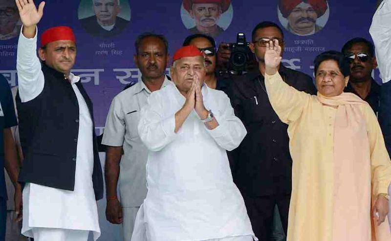 Samajwadi Party patron Mulayam Singh Yadav with Bahujan Samaj Party supremo Mayawati and SP President Akhilesh Yadav during their joint election campaign rally in Mainpuri on Friday. PTI