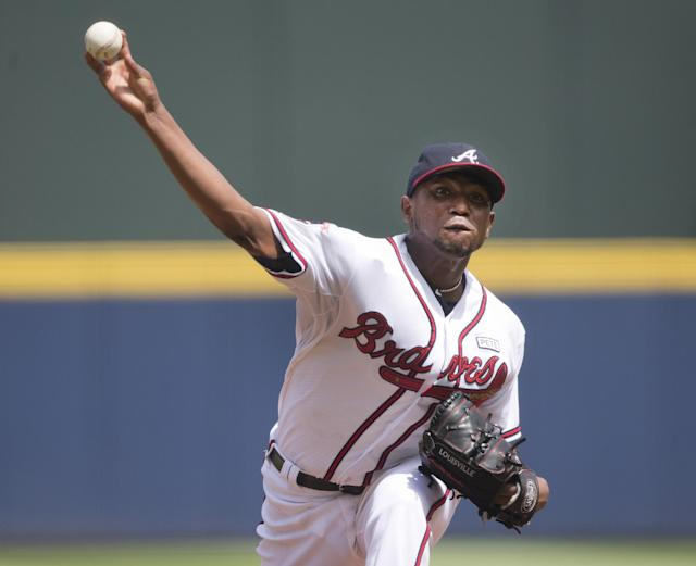 Atlanta Braves starting pitcher Julio Teheran (49) works against the Philadelphia Phillies in the first inning of a baseball game Monday, Sept. 1, 2014, in Atlanta. (AP Photo/John Bazemore)