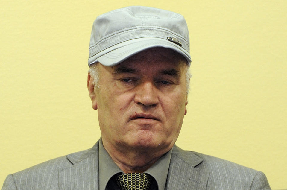 FILE — In this Friday, June 3, 2011 file photo, former Bosnian Serb Gen. Ratko Mladic sits in the court room during his initial appearance at the U.N.'s Yugoslav war crimes tribunal in The Hague, Netherlands. U.N. judges on Tuesday, June 8, 2021 deliver their final ruling on the conviction of former Bosnian Serb army chief Radko Mladic on charges of genocide, war crimes and crimes against humanity during Bosnia's 1992-95 ethnic carnage. Nearly three decades after the end of Europe's worst conflict since World War II that killed more than 100,000 people, a U.N. court is set to close the case of the Bosnian War's most notorious figure. (AP Photo/ Martin Meissner, Pool, File)
