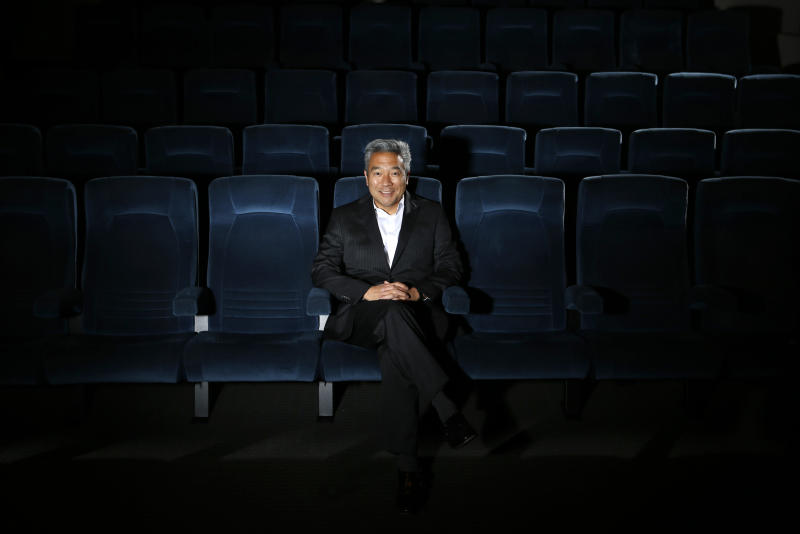 In this Wednesday, Feb. 6, 2013, photo, Kevin Tsujihara, poses for photos in a screening room at the Warner Bros. Studios in Burbank, Calif.  On Friday, Feb. 28, 2013, Tsujihara, 48, who grew up making deliveries as the son of egg distributors, will become the CEO of Warner Bros. Entertainment. The third-generation Japanese-American will be the first Asian-American to head a Hollywood studio.(AP Photo/Jae C. Hong)
