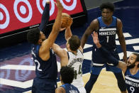 Minnesota Timberwolves' Karl-Anthony Towns , left, defends as Utah Jazz's Bojan Bogdanovic (44) attempts to shoot in the first half of an NBA basketball game, Monday, April 26, 2021, in Minneapolis. (AP Photo/Jim Mone)